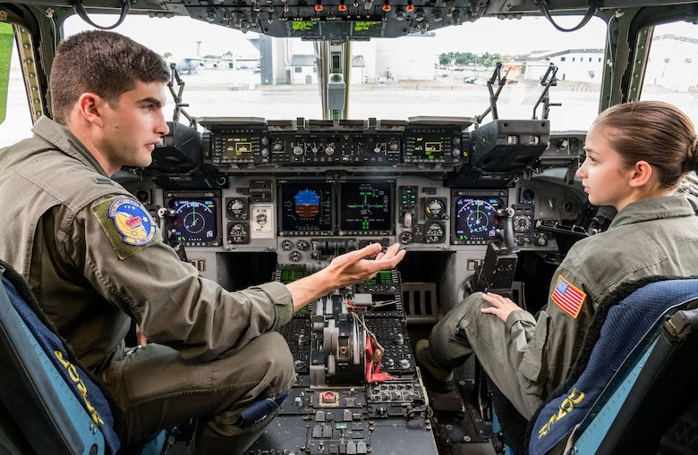 First Lt. Stephen Muer, 3rd Airlift Squadron C-17A Globemaster III pilot, talks with Air Force Junior Reserve Officers' Training Corps cadet Amanda Pieraccini on the flight deck of a C-17A Globemaster III July 23, 2019, at Dover Air Force Base, Del. Pieraccini was one of the 23 cadets who attended the eight-week AFJROTC Summer Flight Academy at Delaware State University in Dover. Pieraccini is a cadet with AFJROTC Detachment NY-932, Aviation High School, Long Island City, N.Y. (U.S. Air Force photo by Roland Balik)