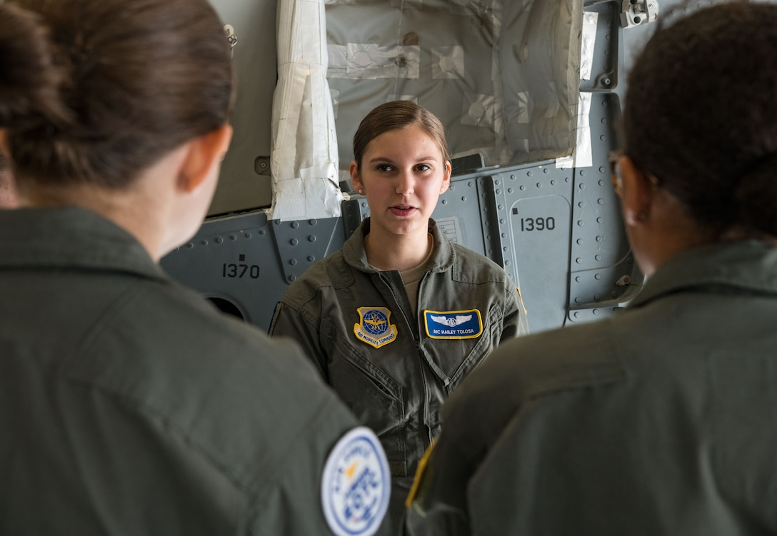 Airman 1st Class Hailey Tolosa, 3rd Airlift Squadron C-17A Globemaster III loadmaster, answers questions from Air Force Junior Reserve Officers' Training Corps cadets about her profession in the Air Force July 23, 2019, at Dover Air Force Base, Del. Cadets who attended the AFJROTC Summer Flight Academy at Delaware State University in Dover, met with Tolosa and other C-17 aircrew members during their half-day tour of the base. (U.S. Air Force photo by Roland Balik)