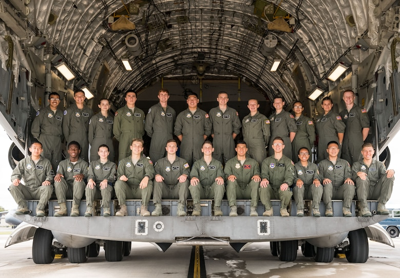 Air Force Junior Reserve Officers' Training Corps cadets pose for a photo on the cargo ramp of a C-17A Globemaster III July 23, 2019, at Dover Air Force Base, Del. Cadets who attended the eight-week AFJROTC Summer Flight Academy held at Delaware State University in Dover, toured aviation-related facilities and aircraft. (U.S. Air Force photo by Roland Balik)