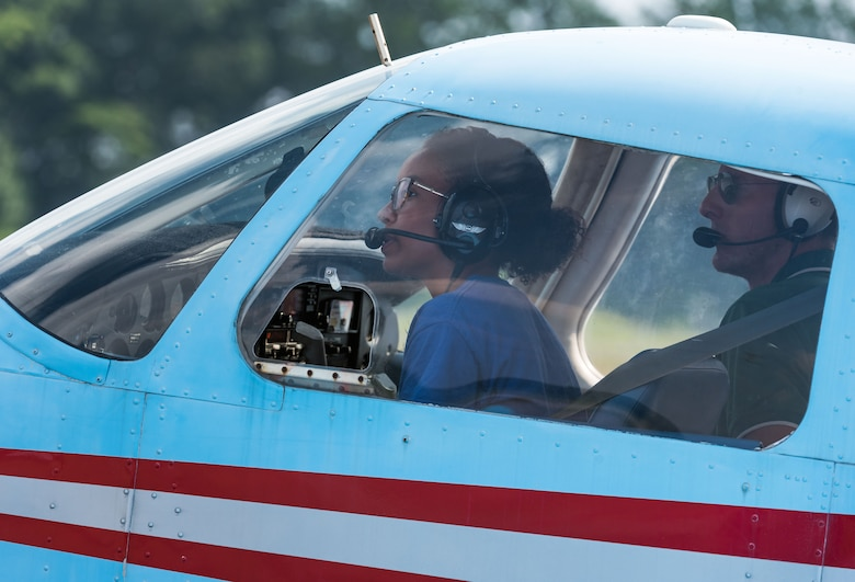 Air Force Junior Reserve Officers' Training Corps cadet Maya Ross, prepares to taxi a Piper Warrior aircraft onto the runway Aug. 6, 2019, at Delaware Airpark in Cheswold, Del. Ross and her Delaware State University certified flight instructor flew around the airpark and practiced skills she learned during the eight-week AFJROTC Summer Flight Academy held at DSU in Dover. Ross is a cadet with AFJROTC Detachment BE-931, SHAPE American High School, Mons, Belgium. (U.S. Air Force photo by Roland Balik)