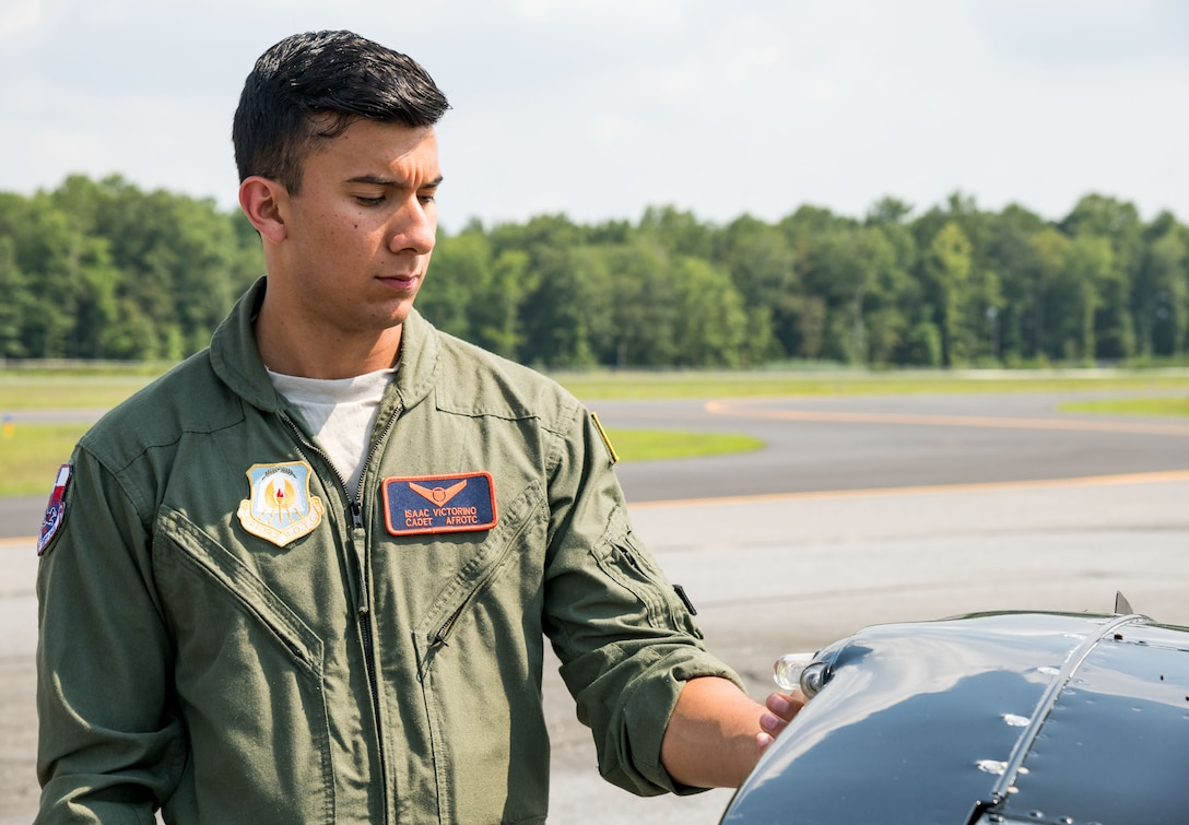 Air Force Reserve Officers' Training Corps cadet Isaac Victorino, checks the left wing strobe light on a Piper Warrior II during the preflight of the aircraft Aug. 6, 2019, at Delaware Airpark in Cheswold, Del. Victorino and Mohammad Ahmed, Delaware State University certified flight instructor, flew around the airpark and practiced skills learned during the eight-week AFJROTC Summer Flight Academy held at DSU in Dover. Victorino is a cadet with AFROTC Detachment 842, University of Texas at San Antonio. (U.S. Air Force photo by Roland Balik)