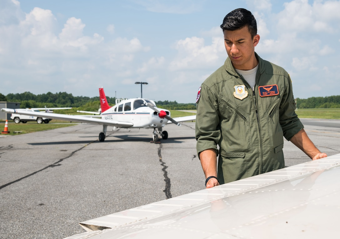 Air Force Junior Reserve Officers' Training Corps cadet Isaac Victorino, checks the left wing on a Piper Warrior II during the preflight of the aircraft Aug. 6, 2019, at Delaware Airpark in Cheswold, Del. Victorino and Mohammad Ahmed, Delaware State University certified flight instructor, flew around the airpark and practiced skills learned during the eight-week AFJROTC Summer Flight Academy held at DSU in Dover. Victorino is a cadet with AFROTC Detachment 842, University of Texas at San Antonio. (U.S. Air Force photo by Roland Balik)