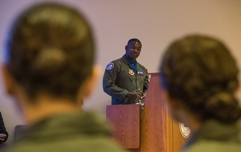 "Maj. Paul ""Loco"" Lopez, U.S. Air Force F-22 Raptor Demonstration Team commander and pilot stationed at Joint Base Langley-Eustis in Hampton, Va., speaks to cadets of the Air Force Junior Reserve Officers' Training Corps Summer Flight Academy during a graduation ceremony held on Aug. 8, 2019, at Delaware State University, Dover, Del. Lopez expressed words of encouragement and praised them on their accomplishment before they received their wings and private pilot's certification during the formal part of the ceremony. (U.S. Air Force photo by Roland Balik)"