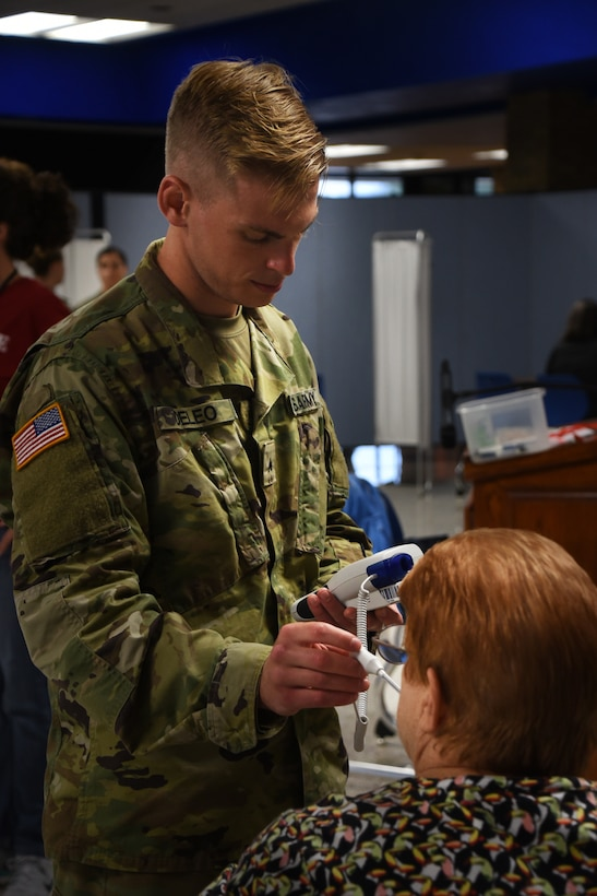 A soldier from the Ohio Army National Guard takes a patients vitals as part of GuardCare Weekend Aug. 10, 2019, at the Buckeye Career Center, New Philadelphia, Ohio. During the event both service members from the Ohio Army and Air National Guard provided health services to the local and surrounding New Philadelphia population. (U.S. Air National Guard photo by Senior Airman Gwendalyn Smith)