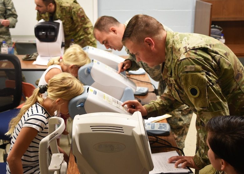 U.S. Air National Guard Lt. Col. Timothy Stuhlmiller, 179th Airlift Wing Medical Group, Mansfield, Ohio, provides a dental examination as part of GuardCare Weekend at the Buckeye Career Center, New Philadelphia, Ohio, Aug. 10, 2019. GuardCare offers the opportunity for community members to receive basic health care and advice. (U.S. Air National Guard photo by Senior Airman Gwendalyn Smith)