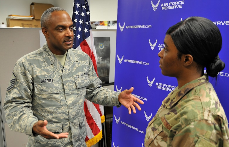 Master Sgt. David Gaffney, 403rd Wing recruiter, explains the Air Reserve Technician application process with Senior Airman Andrea Bradley, 403rd Logistics Readiness Squadron decentralized material support supply technician, during the Unit Training Assembly at Keesler Air Force Base, Biloxi, Mississippi, Aug. 3, 2019. Gaffney assists service members applying for full time ART positions within the 403rd Wing. (U.S. Air Force photo by Tech. Sgt. Michael Farrar)