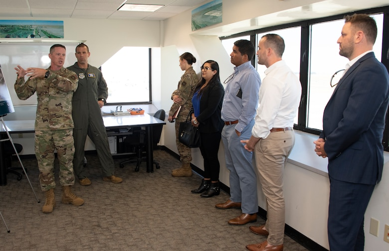 U.S. Air Force Senior Master Sgt. Keith Bennett, left, KC-46 Program Integration Office superintendent, briefs during a tour Aug. 13, 2019 at the control tower, Travis Air Force Base, California.  Representatives for California Senators Diane Feinstein and Kamala Harris visited Travis AFB to gain better knowledge of the mission and discuss the strategic importance of the base. (U.S. Air Force photo by Heide Couch)