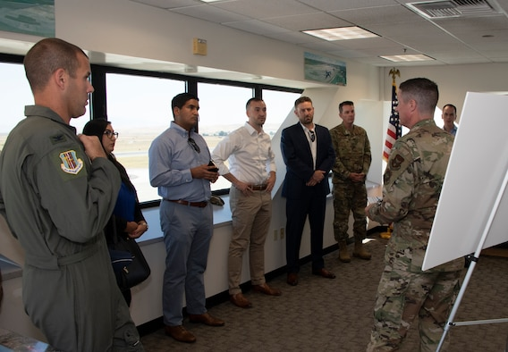 U.S. Air Force Senior Master Sgt. Keith Bennett, right, KC-46 Program Integration Office superintendent, briefs during a tour, Aug. 13, 2019 at the control tower, Travis Air Force Base, California.  Representatives for California Senators Diane Feinstein and Kamala Harris visited Travis AFB to gain better knowledge of the mission and discuss the strategic importance of the base. (U.S. Air Force photo by Heide Couch)