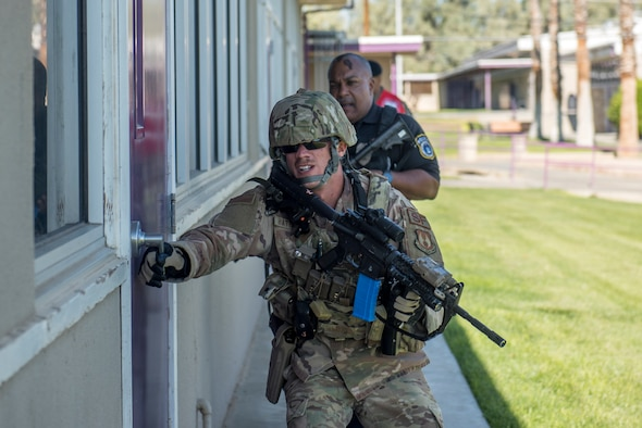 Members of the 412th Security Forces Squadron conduct a security sweep of Desert Junior-Senior High School during an active-shooter exercise at Edwards Air Force Base, California, Aug. 9. (U.S. Air Force photo by Richard Gonzales)