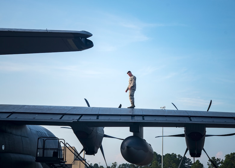 An Airman from the 71st Aircraft Maintenance Unit (AMU) inspects the tail rotor of an HC-130J Combat King II, Aug. 13, 2019, at Moody Air Force Base, Ga. Airmen from the 71st AMU perform various tasks prior to takeoff to ensure the aircraft is performing optimally to complete its mission of supporting the 71st Rescue Squadron. Those tasks consist of: pre-flight inspection, removing plugs and cover, repairing any problems found during crew pre-flight checks as well as marshaling the aircraft for takeoff. (U.S. Air Force photo by Airman 1st Class Eugene Oliver)
