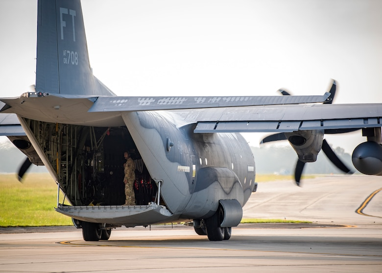 An Airman from the 71st Aircraft Maintenance Unit (AMU), inspects an HC-130J Combat King II, Aug. 13, 2019, at Moody Air Force Base, Ga. Airmen from the 71st AMU perform various tasks prior to take off to ensure the aircraft is performing optimally to complete its mission of supporting the 71st Rescue Squadron. Those tasks consist of: pre-flight inspection, removing plugs and cover, repairing any problems found during crew pre-flight checks as well as marshaling the aircraft for takeoff. (U.S. Air Force photo by Airman 1st Class Eugene Oliver)
