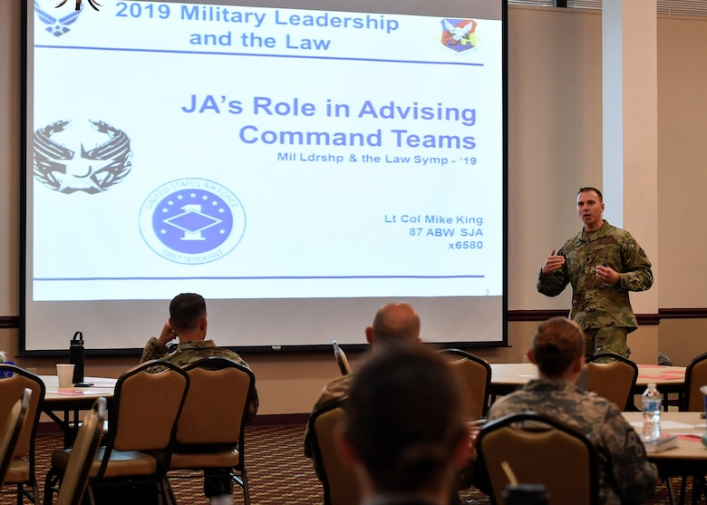 U.S. Air Force Lt. Col. Mike King, 87th Staff Judge Advocate commander, gives a presentation on how SJA can assist commanders making tough legal decisions during a Military Leadership and the Law Symposium held on Joint Base McGuire-Dix-Lakehurst, New Jersey, Aug. 13, 2019. King emphasized that SJA wants to be in-step with leadership teams throughout the installation to make legal decisions smoother and in a fair and timely manner. Other topics that were discussed at the event included ethics, legal assistance and the Area Defense Council. (U.S. Air Force photo by Senior Airman Jake Carter)