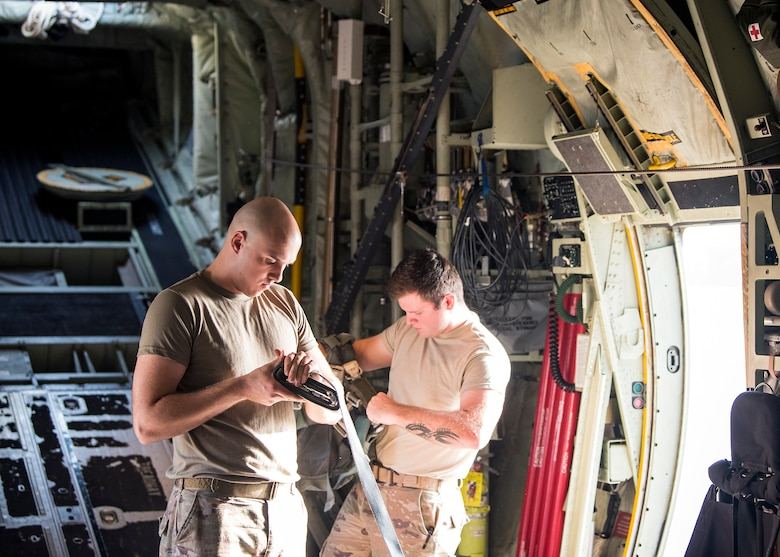 Airman 1st Class Gary Scott, left, 347th Operations Support Squadron aircrew flight equipment apprentice, performs a pre-flight inspection, Aug. 13, 2019, at Moody Air Force Base, Ga. Airmen from the 71st Aircraft Maintenance Unit and other supporting units perform various tasks prior to takeoff to ensure the aircraft is performing optimally to complete its mission of supporting the 71st Rescue Squadron. Those tasks consist of: pre-flight inspection, removing plugs and cover, repairing any problems found during crew pre-flight checks as well as marshaling the aircraft for take-off. (U.S. Air Force photo by Airman 1st Class Eugene Oliver)