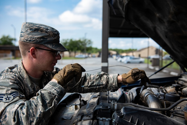 Senior Airman Alex Koch, 23d Logistics Readiness Squadron ground transportation operator, checks fluid levels during a vehicle inspection, Aug. 12, 2019, at Moody Air Force Base, Ga. The ground transportation flight inspects and completes preventative maintenance on all of their 56 vehicles weekly to ensure they remain operational as well as to sustain the longevity of the fleet. (U.S. Air Force photo by Senior Airman Erick Requadt)