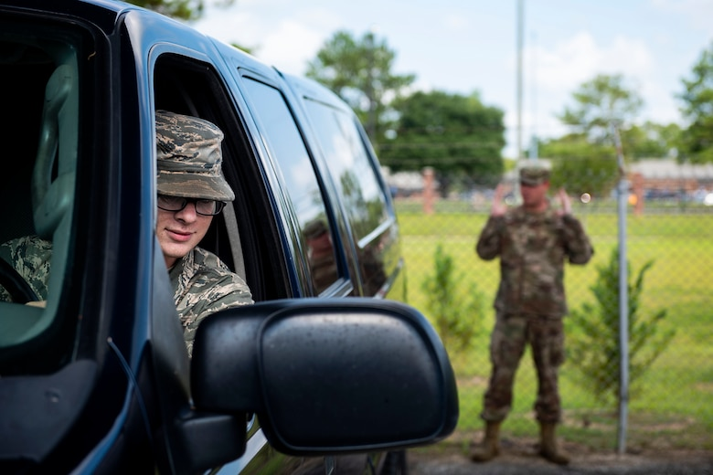 Senior Airman Alex Koch, 23d Logistics Readiness Squadron ground transportation operator, checks break lights during a vehicle inspection, Aug. 12, 2019, at Moody Air Force Base, Ga. The ground transportation flight inspects all of their 56 vehicles weekly to ensure they remain operational, and by performing routine inspections, they're able to maintain the longevity of their fleet. (U.S. Air Force photo by Senior Airman Erick Requadt)