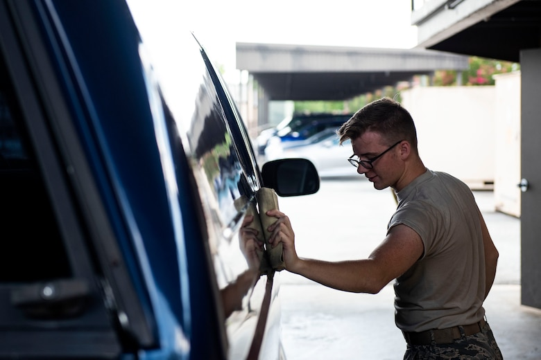 Senior Airman Alex Koch, 23d Logistics Readiness Squadron ground transportation operator, dries off a truck during a vehicle inspection, Aug. 12, 2019, at Moody Air Force Base, Ga. The ground transportation flight inspects all of their 56 vehicles weekly to ensure they remain operational, and by performing routine inspections, they're able to maintain the longevity of their fleet. (U.S. Air Force photo by Senior Airman Erick Requadt)