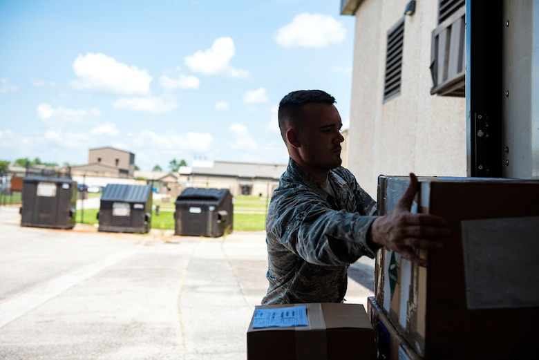 Airman 1st Class Timothy Hankins, 23d Logistics Readiness Squadron documented cargo operator, unloads cargo during a cargo sweep, Aug. 13, 2019, at Moody Air Force Base, Ga. The documented cargo section is responsible for transporting mission-critical equipment and material to squadrons across the base, which helps facilitate mission execution. (U.S. Air Force photo by Senior Airman Erick Requadt)