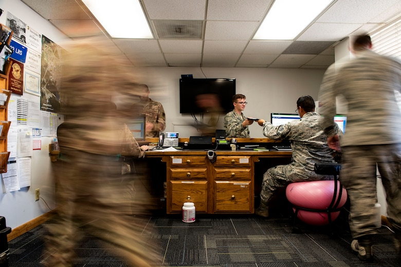 Airmen from the 23d Logistics Readiness Squadron ground transportation flight perform dispatch procedures, Aug. 14, 2019, at Moody Air Force Base, Ga. All of the information ground transportation needs to support the base is first processed through the dispatch section, where it's disseminated to the appropriate areas. Having a centralized point of information flow serves to sustain continuity throughout the sections to ensure optimal communication within the flight. (U.S. Air Force photo by Senior Airman Erick Requadt)