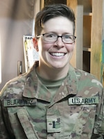 1st Lt. Lori Blakeway, 1972d Medical Detachment, the officer in charge for a behavioral health outpost, poses for a photo at Erbil, Iraq, July 29, 2019.