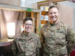 1st Lt. Lori Blakeway and Sgt. Cory Nottingham, 1972d Medical Detachment, stand for a photo at Erbil, Iraq, July 29, 2019.