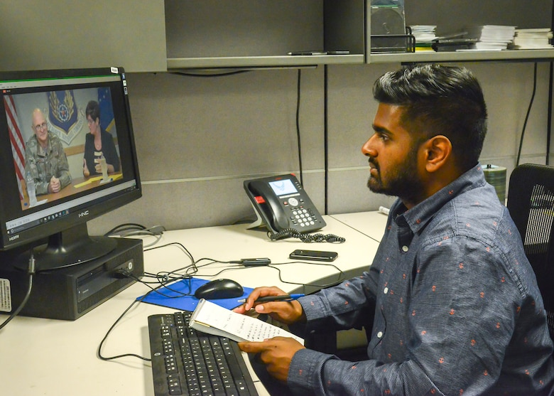 Team Edwards member Miran Gunaratne watches a livestream of Air Force Materiel Command commanding general Gen. Arnold Bunch's Town Hall from his workstation at Edwards Air Force Base, California, Aug. 8. (U.S. Air Force photo by Giancarlo Casem)