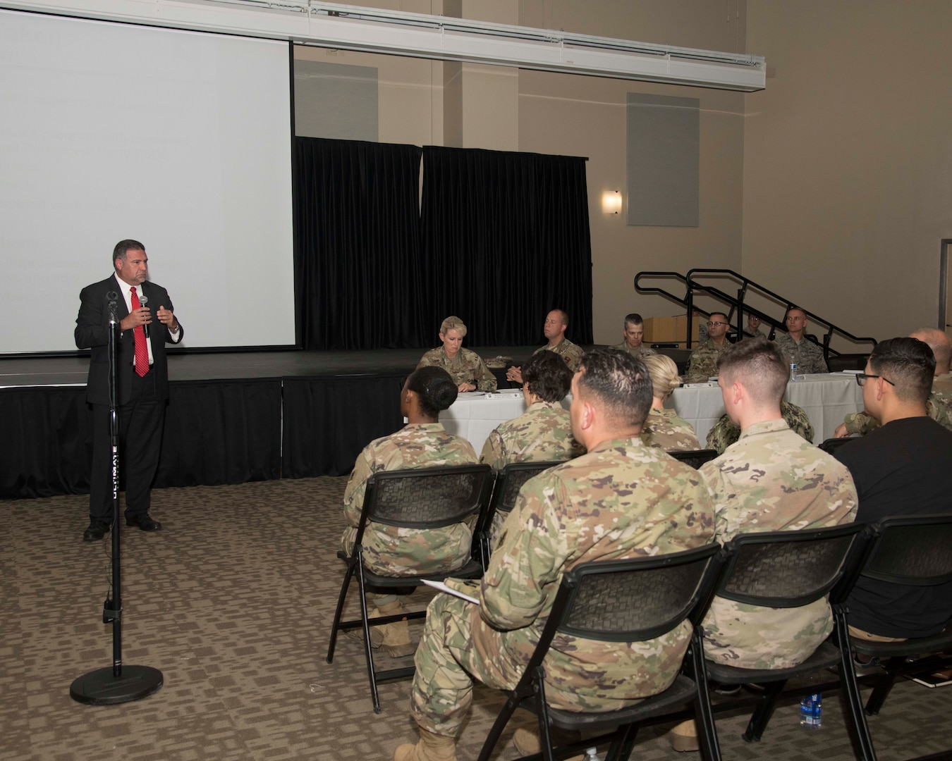 Richard Trevino, the 502nd Civil Engineering Group director, discusses the steps being taken to combat mold with residents of JBSA-Fort Sam Houston's barracks, ships, and dorms during a gathering on Aug. 13. The meeting offered service members an opportunity to directly address issues about their housing with senior leadership. (Photo by Tristin English)