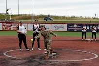 Maj. Rebecca Spohr, assigned to the 85th U.S. Army Reserve Support Command, throws in a ceremonial first pitch before the Chicago Bandits home game vs. the United States Specialty Sports Association Pride team at Parkway Bank Sports Complex, August 11, 2019, in Rosemont, Illinois.