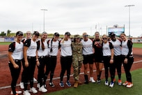 Maj. Rebecca Spohr, assigned to the 85th U.S. Army Reserve Support Command, pauses for a photo with the Chicago Bandits softball team, before the Bandits home game vs. the United States Specialty Sports Association Pride team at Parkway Bank Sports Complex, August 11, 2019, in Rosemont, Illinois.