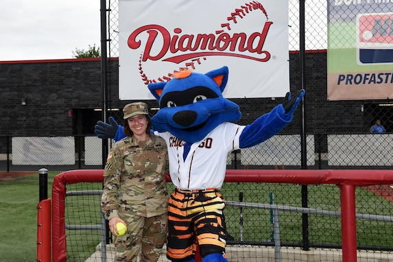 Maj. Rebecca Spohr, assigned to the 85th U.S. Army Reserve Support Command, pauses for a photo with Swiper, the mascot of the Chicago Bandits softball team, before the Bandits home game vs. the United States Specialty Sports Association Pride team at Parkway Bank Sports Complex, August 11, 2019, in Rosemont, Illinois.