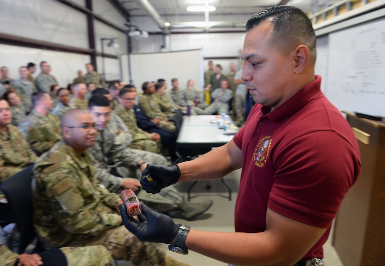 John Camacho, 50th Security Forces Squadron investigator, familiarizes Airmen on controlled substances at the 50th SFS training complex at Schriever Air Force Base Colorado, Aug. 8, 2019. The squadron used confiscated controlled substances in a training environment to teach Airmen and senior leaders how to identify controlled substances. (U.S. Air Force photo by Dennis Rogers)
