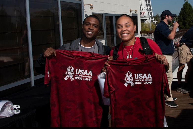 U.S. Air Force Master Sgt. Brandon Jackson, left, 60th Force Support Squadron career assistance advisor, and Tech. Sgt. Parris Cunningham, 60th FSS Sgt. Paul P. Ramoneda Airman Leadership School instructor, display their Salute to Service jerseys Aug. 13, 2019, in Santa Clara, California. Jackson and Cunningham joined 48 other Airmen from Travis Air Force Base, California, in a Salute to Service Boot Camp at the San Francisco 49ers practice facility. (U.S. Air Force photo by Tech. Sgt. James Hodgman)