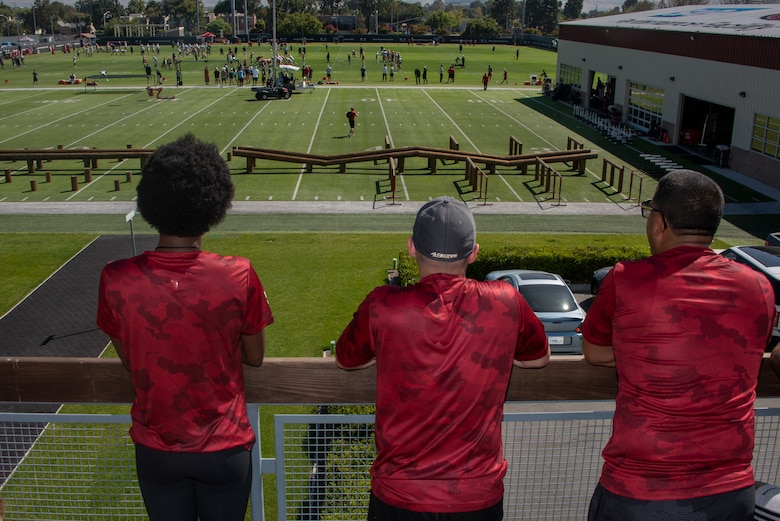 U.S. Airmen from Travis Air Force Base, California, watch as the San Francisco 49ers practice Aug. 13, 2019, during the Salute to Service Boot Camp in Santa Clara, California. Fifty Airmen attended the event from numerous units. The event provided Airmen with an opportunity to interact with NFL players and compete against one another in a variety of athletic drills. (U.S. Air Force photo by Tech. Sgt. James Hodgman)