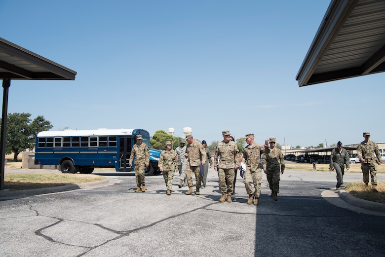 Lt. Gen. Brad Webb, commander of Air Education and Training Command (AETC), and Chief Master Sgt. Juliet Gudgel, the Command Chief Master Sergeant of AETC, visit with members of the 47th Flying Training Wing's senior leadership during an immersion tour Aug. 14, 2019, at Laughlin Air Force Base, Texas. Laughlin is one of only three bases that conducts specialized undergraduate pilot training for the U.S. Air Force. (U.S. Air Force photo by Staff Sgt. Benjamin N. Valmoja).