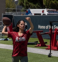 A U.S. Airman from Travis Air Force Base, California, prepares to participate in the quarterback arm challenge Aug. 13, 2019, during the Salute to Service Boot Camp in Santa Clara, California. The event provided Airmen with an opportunity to interact with NFL players and compete against one another in a variety of athletic drills. (U.S. Air Force photo by Tech. Sgt. James Hodgman)