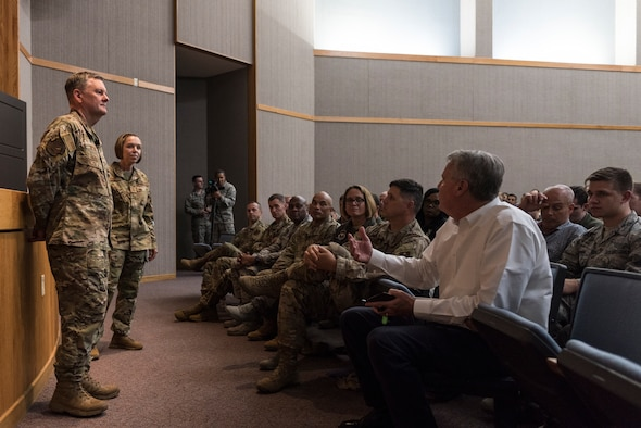 U.S. Air Force Lt. Gen. Brad Webb, commander of Air Education and Training Command (AETC), and Chief Master Sgt. Juliet Gudgel, AETC command chief master sergeant, participate in a Q&A with Airmen assigned to the 47th Flying Training Wing during an immersion tour Aug. 14, 2019, at Laughlin Air Force Base, Texas. During the briefing, Webb and Gudgel got a chance to introduce themselves and hear from people at Laughlin. (U.S. Air Force photo by Senior Airman Anne McCready).