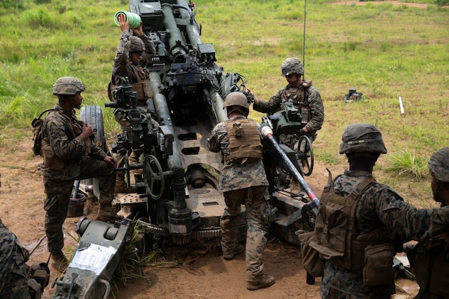 U.S. Marines with 3rd Reconnaissance Battalion, and Marines with 3rd Battalion, 12th Marine Regiment, 3rd Marine Division, prepare to fire an M777 Howitzer during the Artillery Relocation Training Program in Ojojihara, Japan, July 30, 2019. ARTP is an exercise in Japan that provides artillery Marines an opportunity to train and enhance their capabilities. (U.S. Marine Corps photo by Lance Cpl. Christine Phelps)