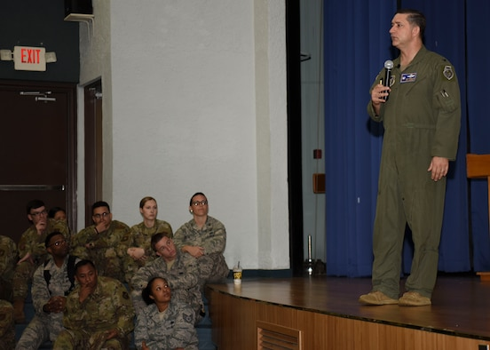 Col. John Gonzales, 51st Fighter Wing commander, briefs Airmen on the upcoming Resilience Tactical Pause day during his first all call inside the base theater at Osan Air Base, Republic of Korea, August 12, 2019. During the brief, Gonzales took time to brief Airmen on his priorities and vision, as well as holding a question and answer session. (U.S. Air Force photo by Senior Airman Denise Jenson)