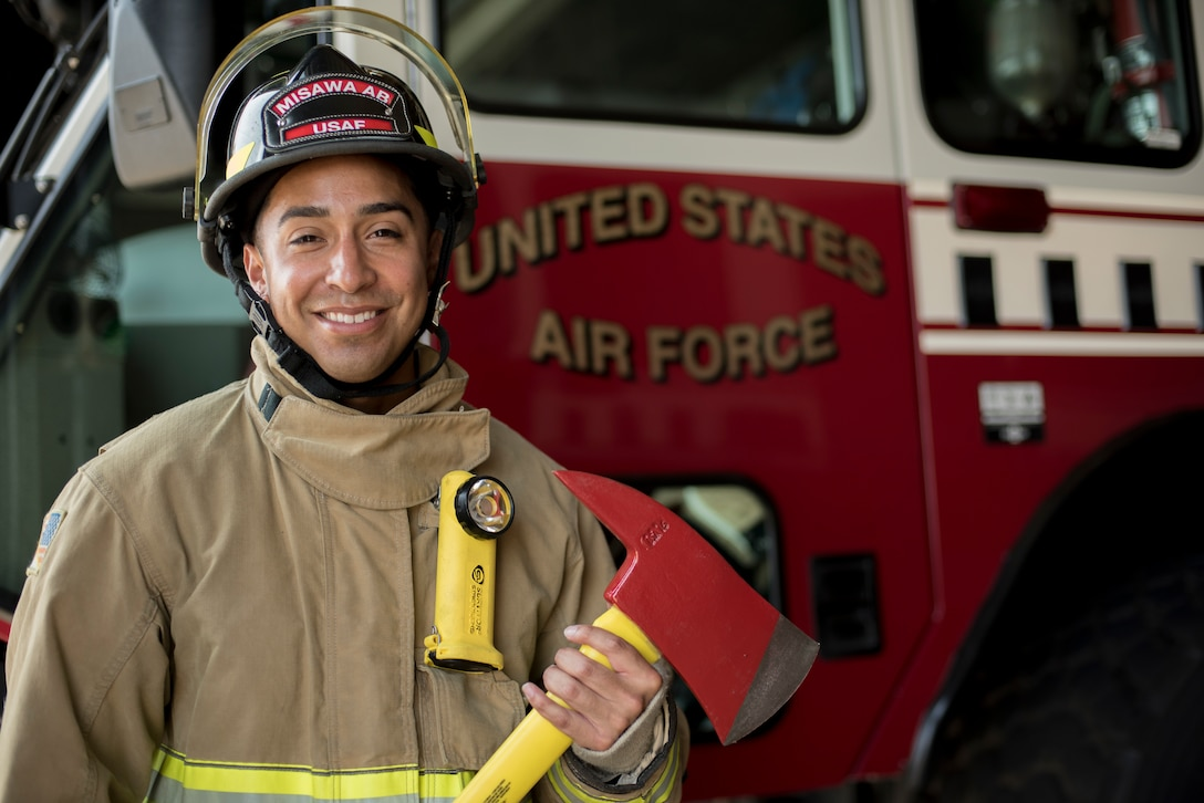 U.S. Air Force Airman 1st Class Adam Cardona, a 35th Civil Engineer Squadron fire protection journeyman, pauses for a photo at Misawa Air Base, Japan, Aug. 7, 2019. The Dallas, Texas, native attended firefighter training for three months prior to receiving orders to his first base, Misawa AB, which resulted in him feeling anxious, but he found solace through the welcoming embrace of local American and Japanese community members. (U.S. Air Force photo by Senior Airman Collette Brooks)