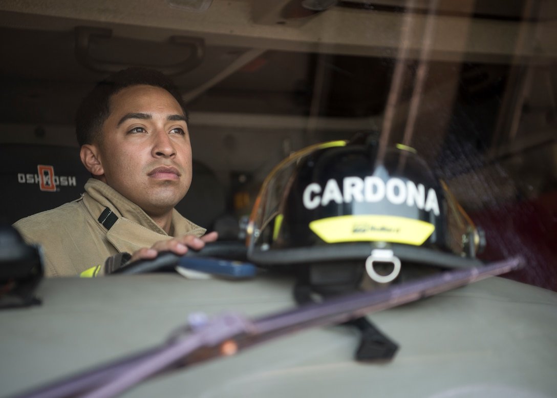 U.S. Air Force Airman 1st Class Adam Cardona, a 35th Civil Engineer Squadron fire protection journeyman, drives a fire truck at Misawa Air Base, Japan, Aug. 7, 2019.  Cardona came to Misawa AB a year and half ago and has made Misawa feel like home by enjoying activities such as sightseeing, fireworks shows and local eateries. (U.S. Air Force photo by Senior Airman Collette Brooks)