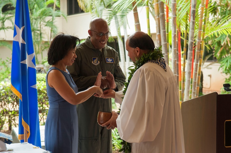 Kahu Kordell Kekoa, a local pastor, placed rainwater on the hands of Gen. CQ Brown, Jr., Pacific Air Forces commander, and his wife, Sharene during a 75th anniversary ceremony in the Courtyard of Heroes at Headquarters PACAF, Aug. 2, 2019. The Far East Air Forces was activated on Aug. 3, 1944 at Brisbane, Australia, under the command of Lt. Gen. George C. Kenney. Over the next 18 months, FEAF moved from Brisbane to New Guinea, the Philippines and then to Japan. The FEAF moved from Fuchu Air station, Japan, to Hickam Air Force Base, Hawaii, on July 1, 1957, and was redesignated Pacific Air Forces. (U.S. Air Force photo by Staff Sgt. Mikaley Kline)