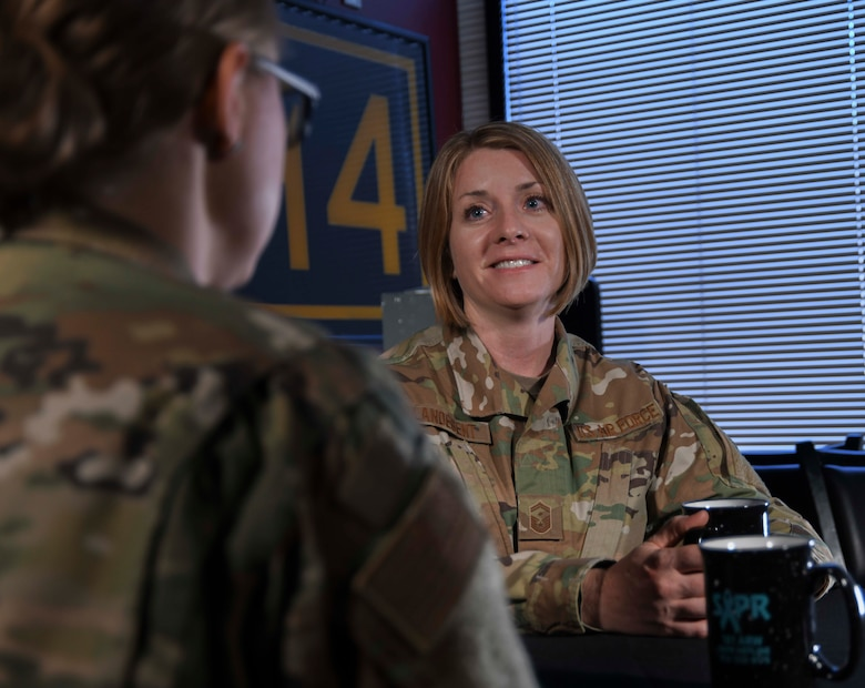 U.S. Air Force 1st Sgt. Rachel L. Landegent, the wing staff and operations group first sergeant with the 161st Air Refueling Wing, Arizona Air National Guard, listens to an Airman during a mentoring session in Phoenix, Ariz., July 2, 2019. Landegent routinely conducts one-on-one mentoring with Airmen in support of their professional and personal development. (Air National Guard photo by Staff Sgt. Morgan R. Lipinski)