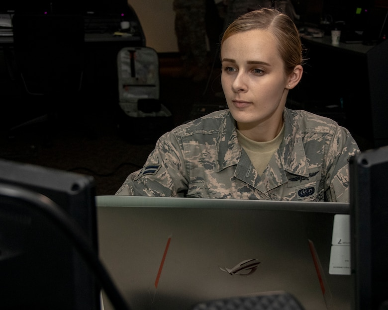 U.S. Air Force Airman 1st Class Kaleigh M. Bevan, a cyberwarfare operator from the 184th Intelligence Wing, Kansas Air National Guard, examines a computer security program in Wichita, Kansas, July 19, 2019. Bevan was recognized as the Air National Guard's 2019 Outstanding Airman of the Year for her commitment to embracing the Whole Airman Concept in both her personal and professional life. (U.S. Air National Guard photo by Master Sgt. David J. Fenner)