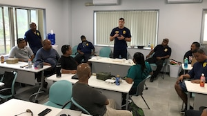 Special Agent Jefferson Fraser conducts a classroom session in Palau as part of the AFOSI Region 6 Special Missions Branch Law Enforcement Investigative Skills Exchange Program with Indo-Pacific partners July 17-19 and 24-26, 2019. (Photo submitted by 6 FIR/SMB)