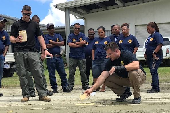 Special Agents Michael Showers, right, and Christopher Stahly conduct a session in the State of Yap as part of the AFOSI Region 6 Special Mission Branch Law Enforcement Investigative Skills Exchange Program with Indo-Pacific partners July 17-19, and 24-26, 2019. (Photo submitted by 6 FIR/SMB)