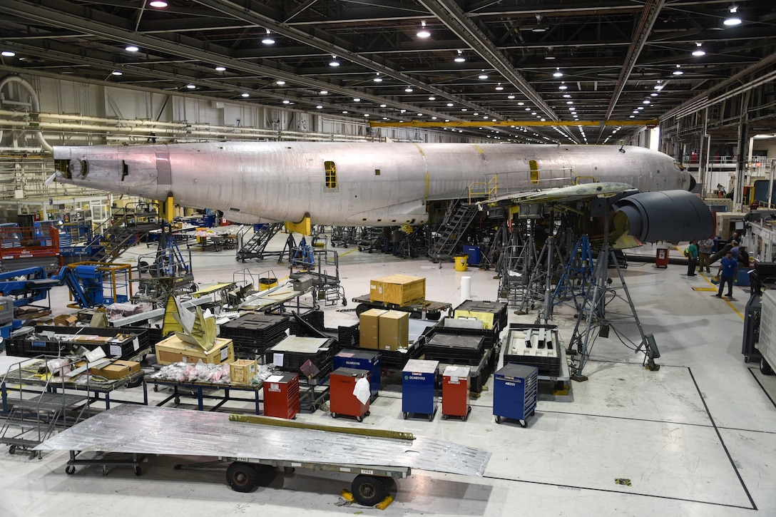 A KC-135R Stratotanker is shown undergoing depot-level maintenance along with parts and supplies (foreground) which were likely acquired through the 448th Supply Chain Management Wing at Tinker Air Force Base, Oklahoma, Sept. 26, 2017. The 448th SCMW let $24.5 million worth of contracts in fiscal year 2017. (U.S. Air Force photo/Greg L. Davis)