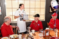 Navy Lt. j.g. Kathleen Spyrnal, an officer programs operations officer assigned to Navy Recruiting District San Antonio, presented a certificate of appreciation to World War II Merchant Marine Ray Denison during an Alamo Honor Flight Breakfast Aug. 14. Attended by other WWII veterans, the breakfast also served as a venue to celebrate Denison's 100th birthday.