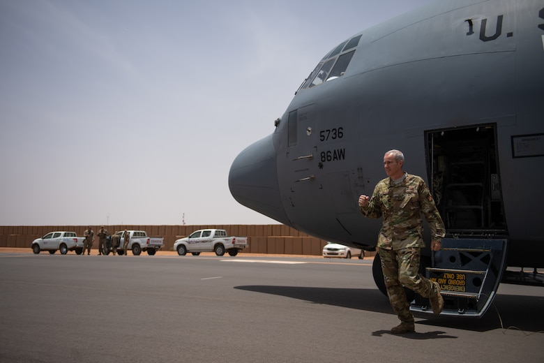 U.S. Air Force Col. Steven J. Jantz, 435th Air Ground Operations Wing and 435th Air Expeditionary Wing commander, steps out of a C-130J Super Hercules at Nigerien Air Base 201, Agadez, Niger, Aug. 3, 2019. Jantz greeted 409th Air Expeditionary Group leadership and their Airmen as the acting wing commander. The aircraft he flew in was the first C-130 to land on Air Base 201, marking the beginning of limited Visual Flight Rules operations at the base. (U.S. Air Force photo by Staff Sgt. Devin Boyer)