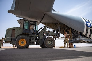 U.S. Air Force Airmen from the 724th Expeditionary Air Base Squadron and the 86th Airlift Wing, unload luggage from a C-130J Super Hercules at Nigerien Air Base 201, Niger, Aug. 3, 2019. This landing marked the next step in airfield evaluations by starting Visual Flight Rules operations at the base. (U.S. Air Force photo by Staff Sgt. Devin Boyer)