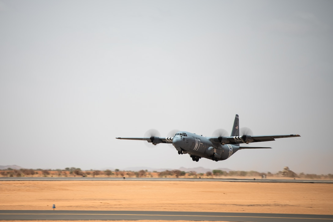 A U.S. Air Force C-130J Super Hercules assigned to the 37th Airlift Squadron at Ramstein Air Base, Germany, takes off from the new runway at Nigerien Air Base 201, Agadez, Niger, Aug. 3, 2019. The 6200-ft runway allows the Air Force to move assets in and out of Air Base 201 and is capable of supporting any aircraft up to a C-17 Globemaster III. (U.S. Air Force photo by Staff Sgt. Devin Boyer)