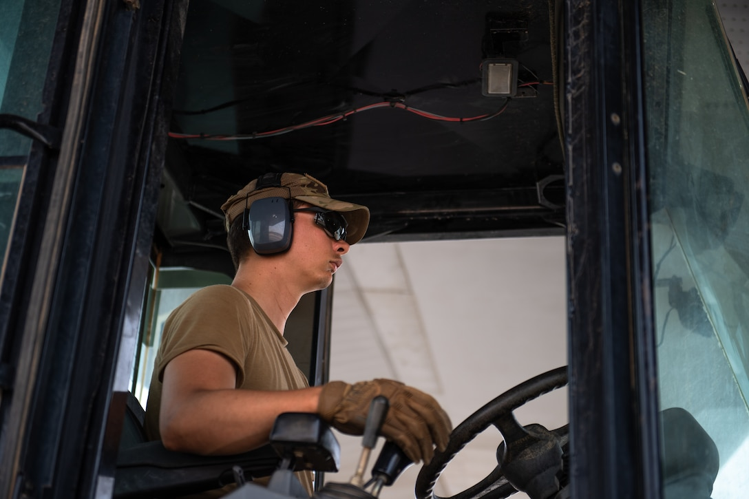 U.S. Air Force Staff Sgt. Dustin Cote, 724th Expeditionary Air Base Squadron air terminal operations center technician, operates a forklift at Nigerien Air Base 201, Agadez, Niger, Aug. 3, 2019. Cote unloaded cargo from the first C-130J Super Hercules to land at Air Base 201, marking the beginning of limited Visual Flight Rules operations at the base. (U.S. Air Force photo by Staff Sgt. Lexie West)
